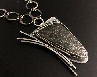 Black speckled stone pendant necklace