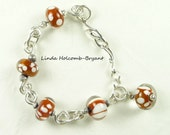 Bracelet of Beige and White Lampwork Glass Beads