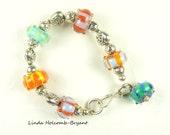Bracelet of Bright Striped Lampwork Beads