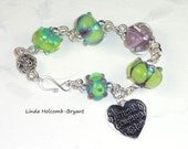 Silver Bracelet of Green & Purple Lampwork Beads