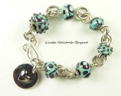 Bracelet of Turquoise and Black Lampwork Beads with Heart Charm