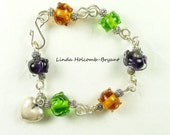 Bracelet of Lampwork Beads with Heart Charm