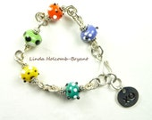 Bracelet of Orange Yellow Green Purple Lampwork Beads