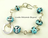 Bracelet - Turquoise Black and White Lampwork Beads