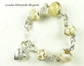 Bracelet of beige and Cream Lampwork Beads