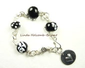 Silver Bracelet of Black & White Lampwork Beads with Heart Charm