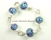 Silver Bracelet of Turquoise & Purple Lampwork Glass Beads