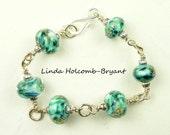 Silver Bracelet of Aqua Lampwork Glass Beads