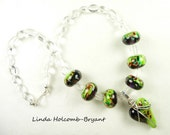 Necklace of Handmade Lampwork Beads of Purple and Green