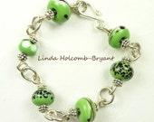 Bracelet of Green White & Black Lampwork Beads