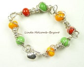 SALE Silver Bracelet of Green, Orange & Red Lampwork Beads