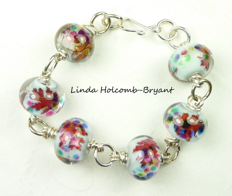 Silver Bracelet of White Pink and Blue Lampwork Beads