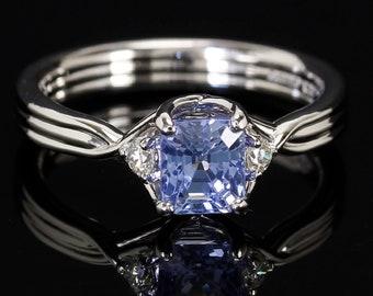 Emerald cut light blue sapphire crossover ring