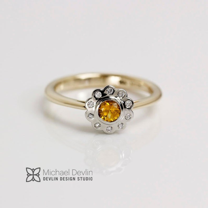Yellow sapphire ring surronded by diamonds 14k two tone ring image 0