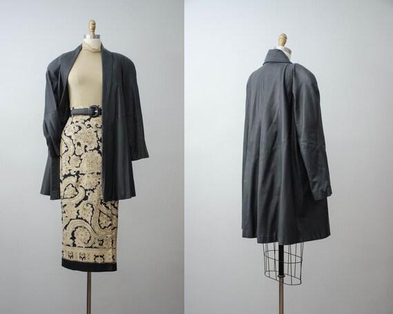 black leather jacket | black swing coat