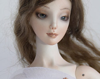 A ball jointed porcelain doll