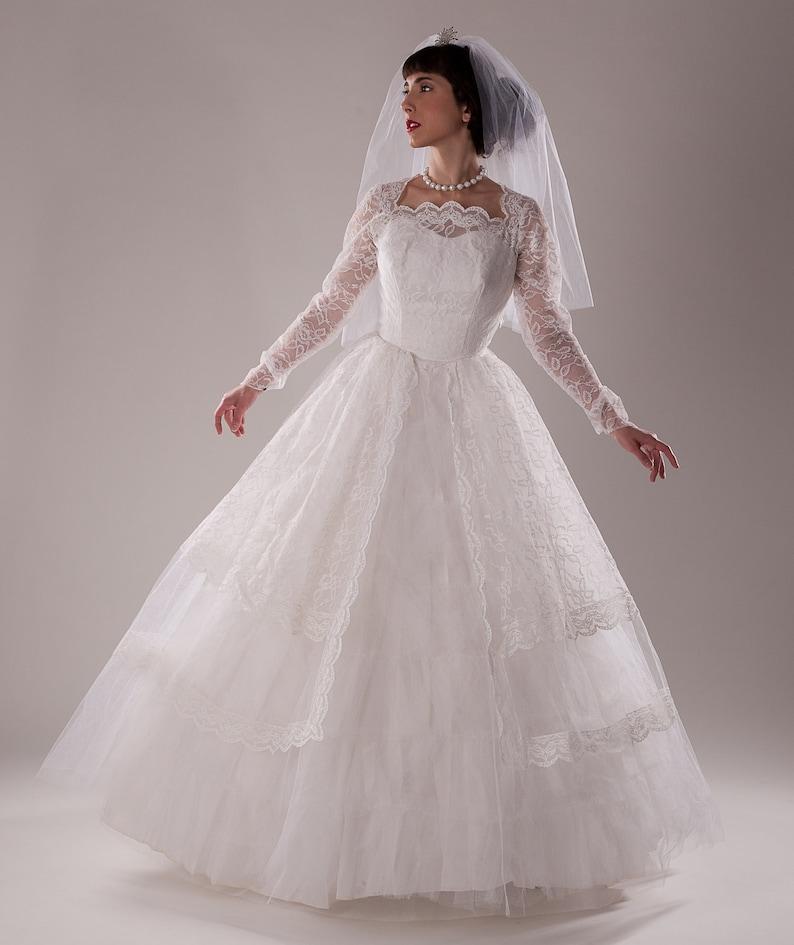 8eaa7b73350329 Vintage 1960s Tulle Wedding Dress Lace Peplum Sleeves | Etsy