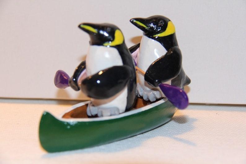 435dcb1e07 Pinguini imperatore in canoa | Etsy