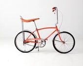 The Schwinn StingRay circa 1972 - orange saddle seat bicycle