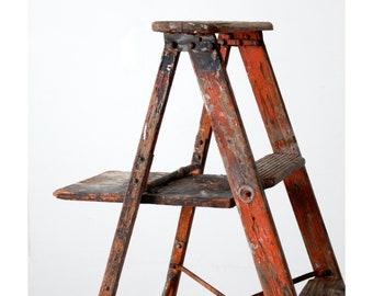 vintage rustic orange wooden ladder