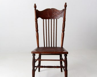 antique press back chair with leather seat