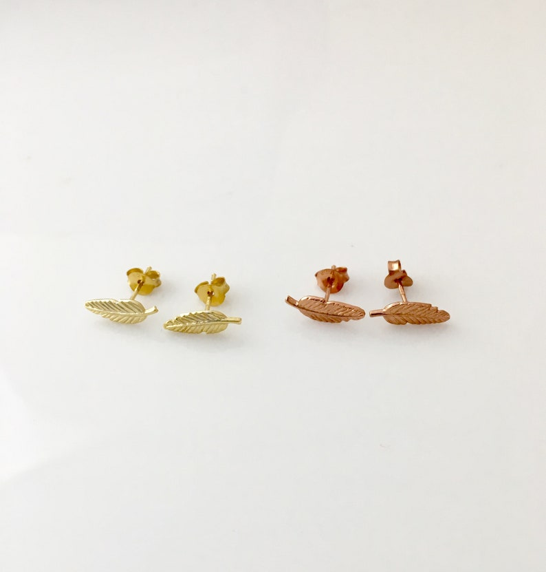 35da15037c714 FEATHER in yellow or rose gold plated sterling silver stud earrings