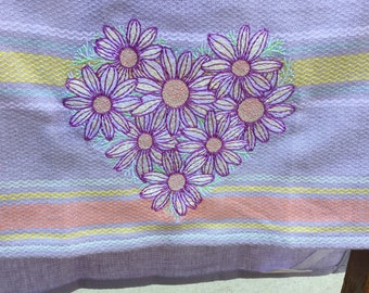 Embroidered daisy towel.