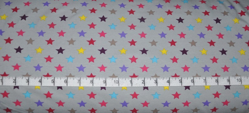 6e33c238145 Stof France. Multi Colored Stars Grey KNIT 63 inches wide By   Etsy