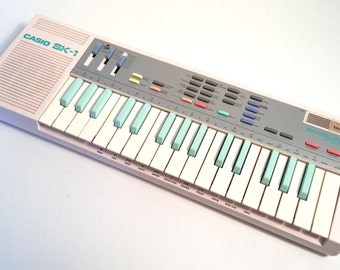 The Holy Grail of Nerdom The Pink Casio SK-1 Sampling Keyboard SK1 sampler and drum machine with original box