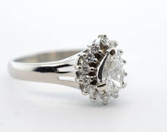 Platinum .33ct Pear Shaped and .17ctw Halo SI1/G-H Ring- Size 5.25