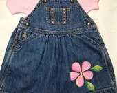 One of a kind baby jean dress, one size only 6-12 months on dress with hand painted flowers