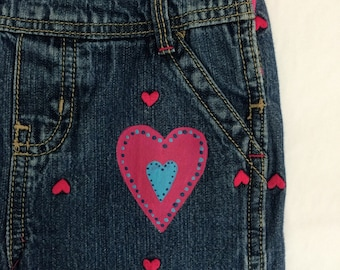 Valentine osh kosh jean overalls  size 3 years. One of a kind overalls with matching tee shirt size 4.
