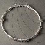 Sterling silver bangle bracelet with sliding rings