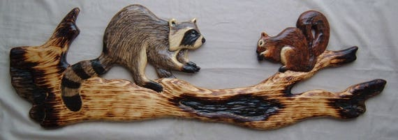 Chainsaw carving raccoon fox squirrel wood log