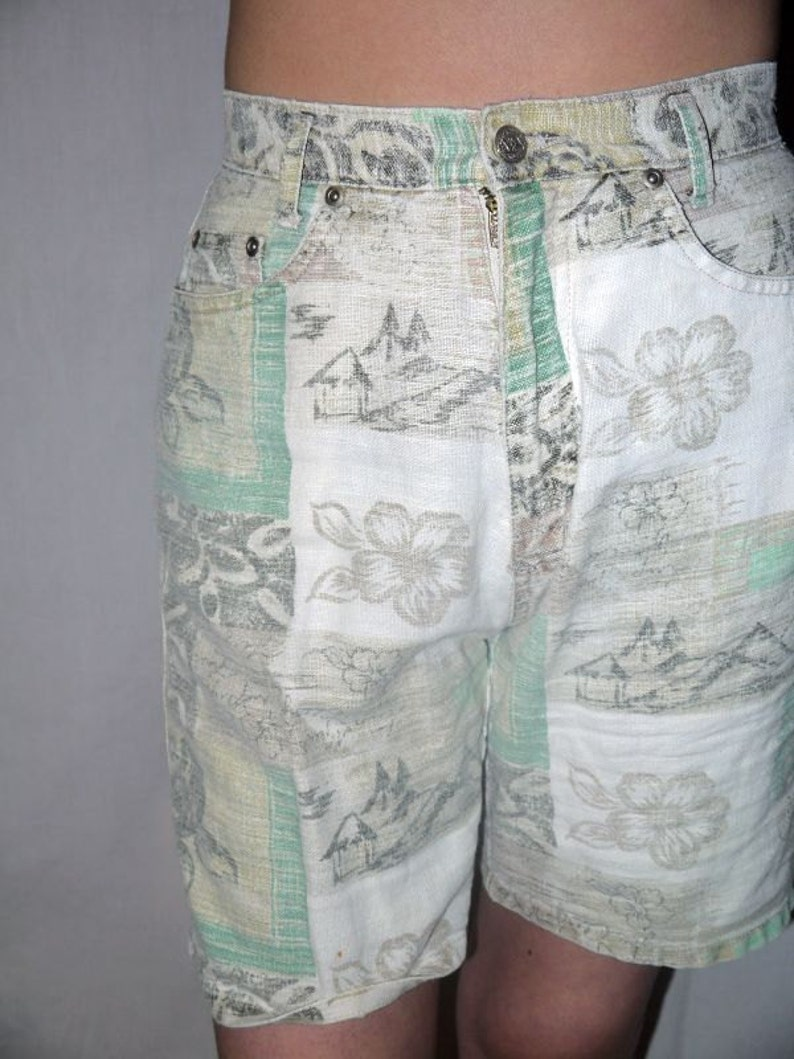 Tribe vibe .. vintage 80s 90s shorts  1980s high waist waisted  floral jeans  hawaiian tropical  roll up DIY cut off    S waist 26
