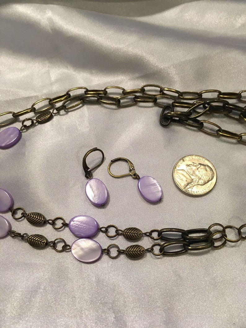 Flower necklace with purple shells  earrings
