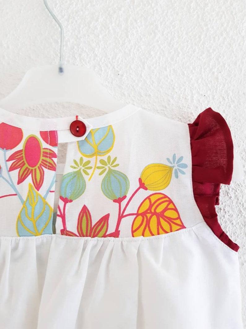 Robe fille en coton blanc 2 ans d\u00e9tails devant imprim\u00e9 oiseaux et manches bouffantes rouges