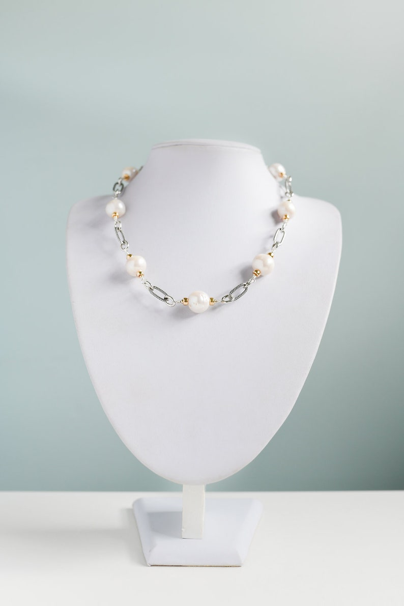 Large and lustrous white freshwater pearl necklace with gold image 0