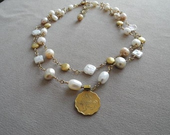 Champagne pearls with vintage Burmese lion coin pendant