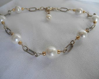 Large and lustrous white freshwater pearl necklace with gold and silver