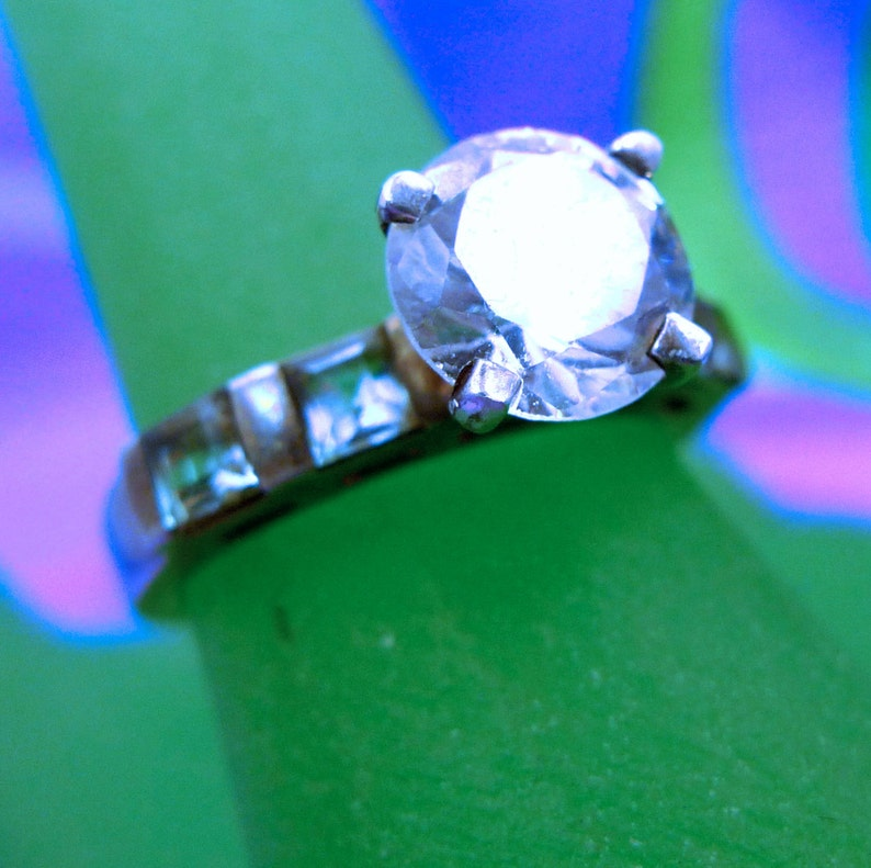 Size 7 Ring Engagement Cubic Zirconia and 4 Blue Topaz Baguettes Marked QJ 925 99.08