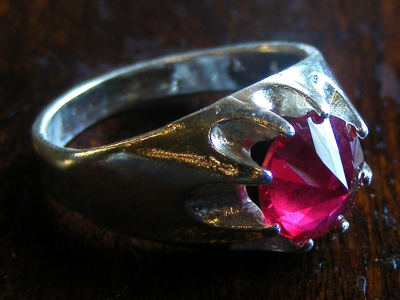 Glass cutter ruby and sterling ring. image 0