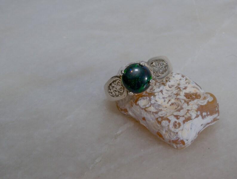 Decorative black opal ring. image 0
