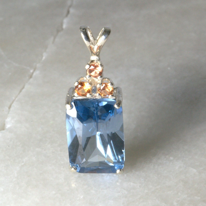 Sapphire pendant with triple padparadscha sapphire accent. image 0