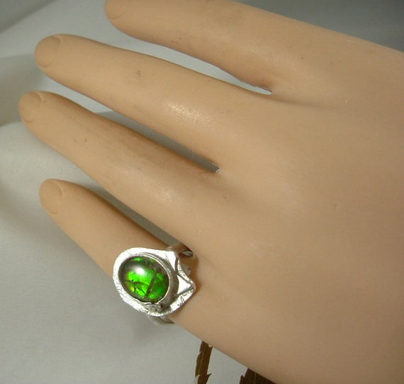 Ammolite ring for lovers of the ammolite rainbow.Top quality four colour gemstone and in your size too.#111318