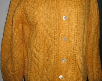Handknitted pumpkin orange mohair sweater
