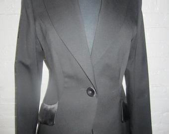 Elegant Escada black jacket  with silk satin collar and pocket cuffs.