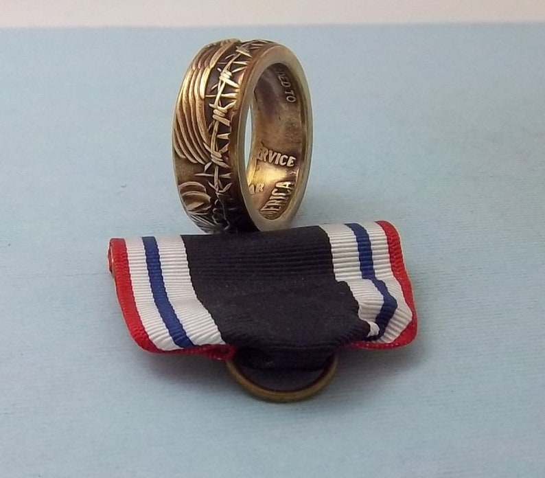This is a POW Prisoner of War Service medal turned into a size 10 12  ring Wear this on your special occasions.