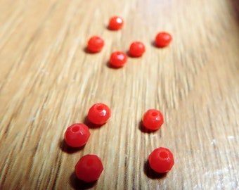 30 tiny red opaque rondelle beads ... size 3mm x 4mm