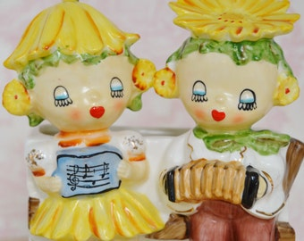 Vintage Lipper and Mann Planter Featuring Flower Children with Yellow Petals